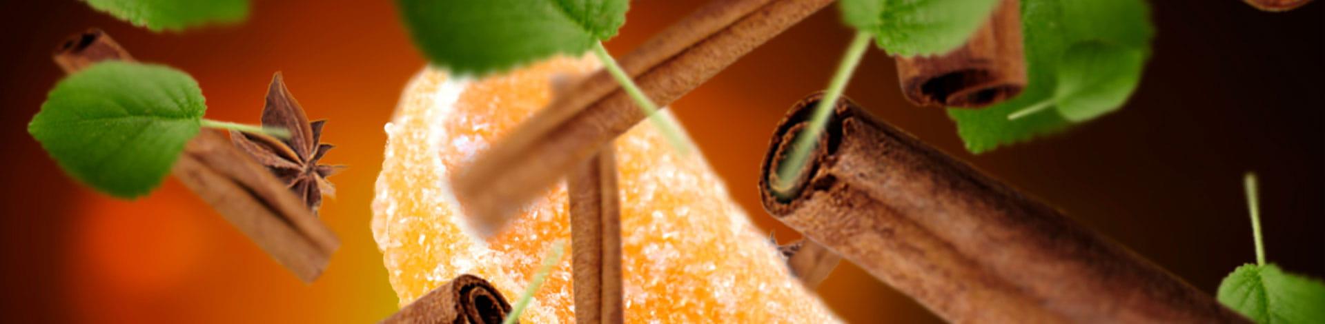 Canela en rama y fruta escarchada aroma oriental